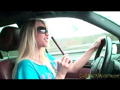 Sexy chick eating beef jerky in the car