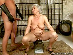 Mature gray haired granny Norma really enjoys in this fetish