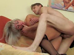 Blonde mature in black gets cock in her box