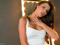 Cindy Hope plays with her smooth pussy near a mirror