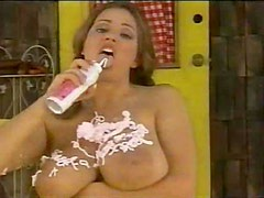 Whipped cream on her huge naked tits