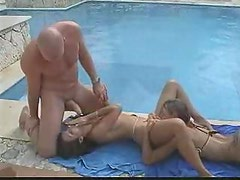 Threesome next to the pool with great oral