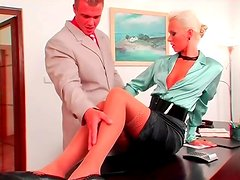 Beauty in a satin blouse and short skirt likes foreplay