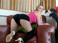 Babe blonde Rose is stretching her shaved pussy