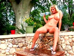 Pretty blonde Jenny McClain is penetrating her shaved pussy