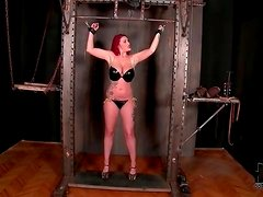 Bound girl in latex bikini gets flogged