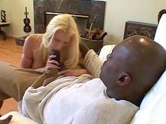 Pretty blonde with big tits takes huge black dick