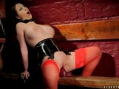 Black leather corset on sexy dildo fucking girl
