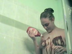 Kinky amateur minx pours paint and cream all over her body