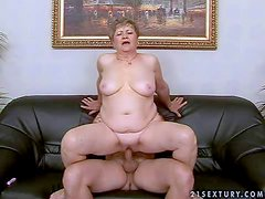 Fat short haired brunette granny with hanging tits rides on