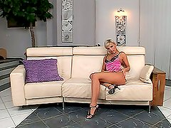 Tattooed blonde Eve Smile toys her cute pussy in the living room