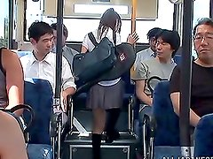 Slutty Busty Japanese Teen Sucks and Fucks Two Cocks in Public Bus