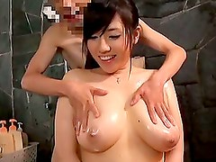 Playing with a Japanese Girl's Huge Tits Before Receiving a Handjob