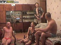 Amateur Girl Sandwiched Between Two Bald Guys in MMF Threesome
