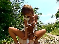 Asian Chick Sticks A Big Hard Toy In Her Cunt Outdoors On A Road.