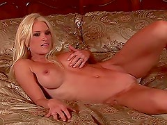 Nikki Minnich the adorable blonde lies on the bed naked