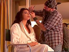 Guy is doing makeup to sexy Tera Patrick before photo shooting