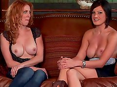 Two slender vixens are talking about cocks topless