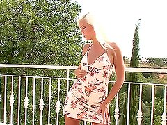 Awesome blonde babe playing with a dildo on the balcony