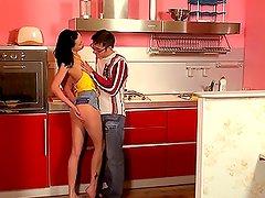 Hot Alice in miniskirt is having sex on a kitchen table