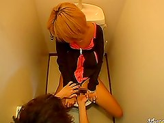 Stunning Japanese woman gets fingered in the restroom