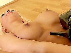 Big tittied blonde in high heels fingers her pussy