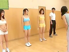 Wild guy fucks some hot Japanese babes in the gym