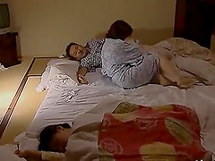 Busty Japanese milf fucks her husband after they fondle each other
