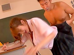 Sexy schoolgirl Miku Ohashi gets fucked by two guys in the classroom