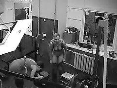 Blond babe gets naked in the room with security camera