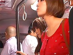 Two pretty Japanese schoolgirls get fucked in a public bus