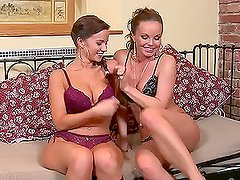 Cindy Dollar and Silvia Saint toy each others pussies on a bed