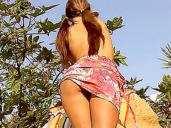 Charming brown-haired chick moans loudly while playing with two dildos