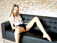 Gorgeous blond teen rubs her tight pussy on the couch