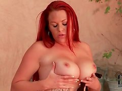 Chubby redhead with tattoos using her toys