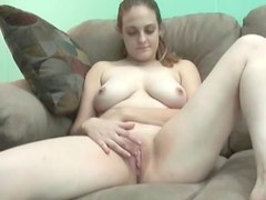Busty brunette with shaved pussy teasing with her dildo