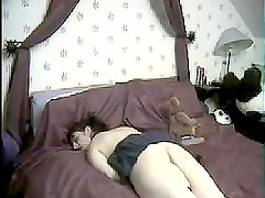 Homemade video of a teen girl masturbating lying face down