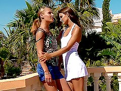 Two gorgeous babes finger fucking each other on the terrace