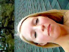 Homemade video of the blonde teen masturbating on the roof