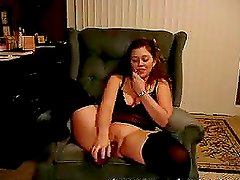 A hot girl smashes her snatch with a dildo while talking on the phone
