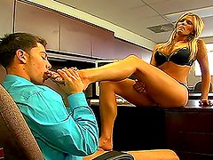 A sexy blonde sucks her toes and gives a footjob to the guy