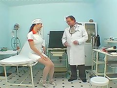 Nasty dark-haired nurse has sex with two guys and gets cum to her face