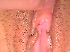 Mouth-watering close up of the babe's shaved pussy