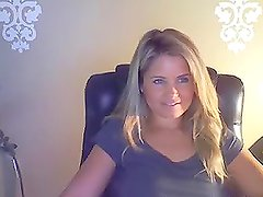 Sexy long-haired babe shows her awesome tits on the webcam