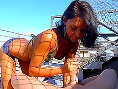 Victoria the sexy tanned brunette gives a handjob on the roof