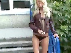 Watch this homemade video containing hot blonde masturbating on her porch