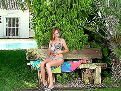 Sweet girl masturbates and plays with dildo on the bench