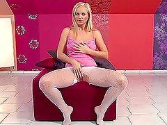 Wonderful blond babe in white fishnet performs solo