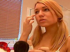 Lovely babe Corri puts a make up on her sweet face