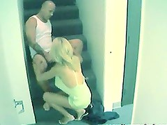 A bald guy fucks his wife on the stairs and enjoys it